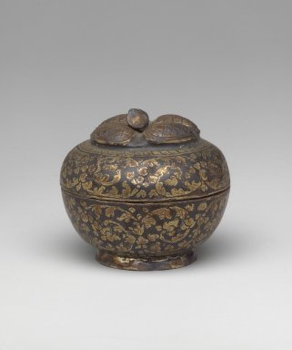 <em>Covered Betel Box (Mangosteen Covered Box)</em>. Silver niello, 4 1/2 x 1 1/4 in. (11.5 x 3.2 cm). Brooklyn Museum, Gift of the Doris Duke Foundation, 2003.64.16a-b. Creative Commons-BY (Photo: Brooklyn Museum, 2003.64.16a-b.jpg)