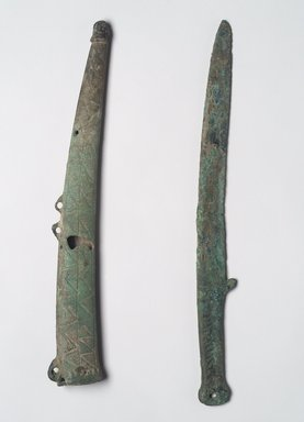 <em>Dagger and Sheath</em>, 7th-6th century B.C.E. Bronze, Dagger (a): 13 x 5 1/16 x 1/4 in. (33 x 12.9 x 0.6 cm). Brooklyn Museum, Anonymous gift, 2003.82.2a-b. Creative Commons-BY (Photo: Brooklyn Museum, 2003.82.2a-b_front.jpg)