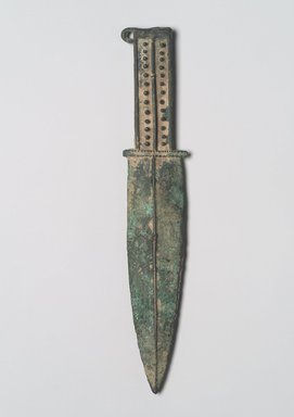 <em>Dagger with Double Edge</em>, 6th-4th century B.C.E. Bronze, 10 3/4 x 2 x 7/16 in. (27.3 x 5.1 x 1.1 cm). Brooklyn Museum, Anonymous gift, 2003.82.4. Creative Commons-BY (Photo: Brooklyn Museum, 2003.82.4.jpg)