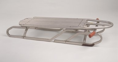"Bertram Lesser (American, born 1924). <em>""Racer"" Sled</em>, patented March 30, 1965. Aluminum, rubber, other metals, 7 1/8 x 43 x 25 in. (18.1 x 109.2 x 63.5 cm). Brooklyn Museum, Gift of M. Christmann Zulli and David J. Ramsay, 2003.86. Creative Commons-BY (Photo: Brooklyn Museum, 2003.86.jpg)"