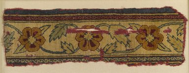 Mughal. <em>Border Fragment of a Pashmina Carpet with Pattern of Lattice and Blossoms</em>, mid 17th century. Pashmina wool pile on silk foundation, 4 3/4 x 14 in. (12.1 x 35.6 cm). Brooklyn Museum, Gift of Nobuko Kajitani, 2004.111 (Photo: Brooklyn Museum, 2004.111_PS4.jpg)