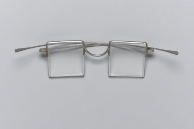<em>Eyeglasses</em>, 20th century. Rock crystal and metal, length folded: 17 cm. Brooklyn Museum, Gift of Dr. Alvin E. Friedman-Kien, 2004.112.24. Creative Commons-BY (Photo: Brooklyn Museum, 2004.112.24_PS1.jpg)