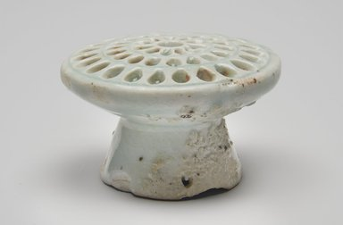 <em>Rice Cake Mold</em>, 19th century. Porcelain, glaze, 1 7/8 x 2 3/4 in. (4.8 x 7 cm). Brooklyn Museum, The Peggy N. and Roger G. Gerry Collection, 2004.28.125. Creative Commons-BY (Photo: , 2004.28.125_PS11.jpg)