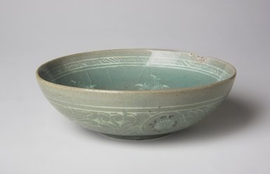 <em>Bowl</em>, 13th century. Stoneware with celadon glaze and inlaid black and white slip, Height: 1 3/4 in. (4.4 cm). Brooklyn Museum, The Peggy N. and Roger G. Gerry Collection, 2004.28.130. Creative Commons-BY (Photo: , 2004.28.130_top_PS11.jpg)
