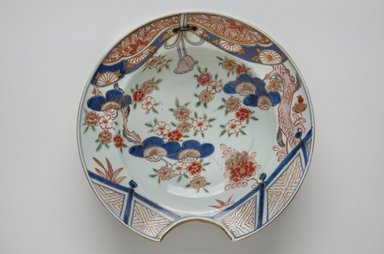 <em>Barber's Bowl</em>, early 18th century. Arita ware, porcelain with underglaze blue and overglaze enamel, 2 15/16 x 10 7/16 in. (7.5 x 26.5 cm). Brooklyn Museum, The Peggy N. and Roger G. Gerry Collection, 2004.28.267. Creative Commons-BY (Photo: Brooklyn Museum, 2004.28.267_top_PS11.jpg)