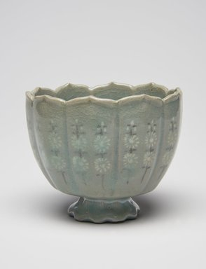 <em>Cup</em>, first half of the 13th century. Stoneware inlaid with black and white slip and celadon glaze, Height: 2 13/16 in. (7.2 cm). Brooklyn Museum, The Peggy N. and Roger G. Gerry Collection, 2004.28.45. Creative Commons-BY (Photo: , 2004.28.45_PS11.jpg)