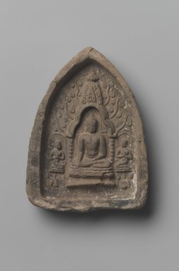 <em>Earth Touching Shakyamuni</em>. Molded terracotta plaque, 3 3/4 x 2 5/8 in. (9.5 x 6.7 cm). Brooklyn Museum, Gift of Jai Chandrasekhar, 2004.3.4. Creative Commons-BY (Photo: Brooklyn Museum, 2004.3.4.jpg)