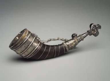 Mende. <em>Horn and Silver Pendant</em>, 19th century. Cow horn, silver, aluminum, 10 1/4 x 3 x 2 1/2 in. (26 x 7.6 x 6.4 cm). Brooklyn Museum, Gift of Blake Robinson, 2004.76.1. Creative Commons-BY (Photo: Brooklyn Museum, 2004.76.1.jpg)