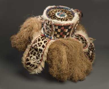 Mende. <em>Gbini Mask</em>, early 20th century. Wood, leopard skin, sheepskin, antelope skin, raffia fiber, raffia fiber twine, cotton cloth, cotton string, cowrie shells, Height: 17 in. (43.2 cm). Brooklyn Museum, Gift of William C. Siegmann, 2004.77a-d. Creative Commons-BY (Photo: Brooklyn Museum, 2004.77a_PS6.jpg)