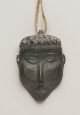 Therese Ukaleannuk (Inuit). <em>Amulet in the Form of a Head, March 1974</em>, 1950-1980. Gray stone, rawhide, 2 3/4 x 1 3/4 x 3/4 in. (7 x 4.4 x 1.9 cm). Brooklyn Museum, Hilda and Al Schein Collection, 2004.79.27. Creative Commons-BY (Photo: Brooklyn Museum, 2004.79.27_PS11-1.jpg)