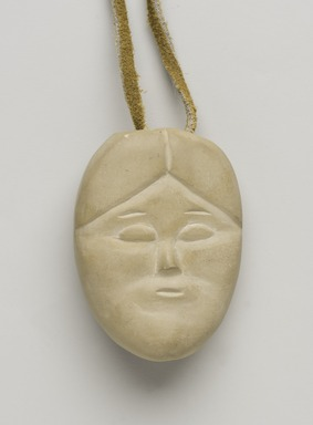 Therese Ukaleannuk (Inuit). <em>Janus-faced Amulet Head, March 1974</em>, 1950-1980. Tan stone, 2 x 1/2 x 3/4 in. (5.1 x 1.3 x 1.9 cm). Brooklyn Museum, Hilda and Al Schein Collection, 2004.79.28. Creative Commons-BY (Photo: Brooklyn Museum, 2004.79.28_PS11-1.jpg)