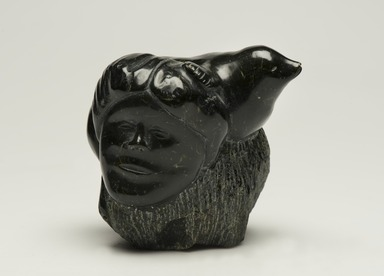Inuit. <em>Human Face in Relief and Seal Figure in the Round</em>, 1950-1980. Soapstone, tuff, 4 x 4 x 3 1/2 in. (10.2 x 10.2 x 8.9 cm). Brooklyn Museum, Hilda and Al Schein Collection, 2004.79.2. Creative Commons-BY (Photo: Brooklyn Museum, 2004.79.2_view01_PS11-1.jpg)