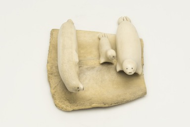 Inuit. <em>Scene with Family of Seals</em>, 1950-1980. Ivory, antler, pigment, 1 5/8 x 3 7/8 x 4 3/4 in. (4.1 x 9.8 x 12.1 cm). Brooklyn Museum, Hilda and Al Schein Collection, 2004.79.56. Creative Commons-BY (Photo: Brooklyn Museum, 2004.79.56_view01_PS11-1.jpg)