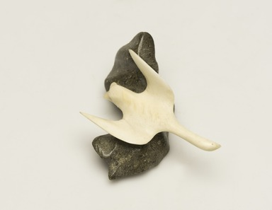 Inuit. <em>Loon on a Rock</em>, 1950-1980. Ivory, gray stone, 1 1/2 x 2 1/2 x 2 5/8 in. (3.8 x 6.4 x 6.7 cm). Brooklyn Museum, Hilda and Al Schein Collection, 2004.79.61. Creative Commons-BY (Photo: Brooklyn Museum, 2004.79.61_view01_PS11-1.jpg)