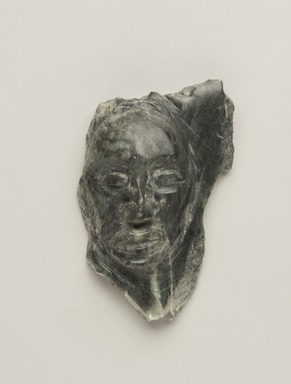 Inuit. <em>Carved Face in Relief</em>, 1950-1980. Green stone, 3 1/2 x 2 1/4 x 1 in. (8.9 x 5.7 x 2.5 cm). Brooklyn Museum, Hilda and Al Schein Collection, 2004.79.65. Creative Commons-BY (Photo: Brooklyn Museum, 2004.79.65_PS11.jpg)