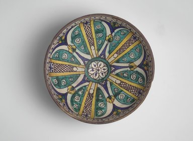 <em>Bowl with Six-Petalled Central Blossom</em>, late 19th-early 20th century. Earthenware with green, yellow, blue, brown and white glazes, Diam: 10 3/4 in. (27.3 cm); Height: 5 in. Brooklyn Museum, Gift of Dr. Charles S. Grippi in honor of the memory of the late Professor Virgil H. Bird, 2004.83.1. Creative Commons-BY (Photo: Brooklyn Museum, 2004.83.1.jpg)