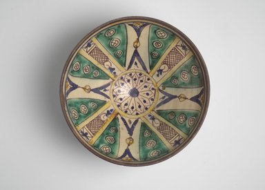 <em>Bowl with Twelve-Pointed Central Star</em>, 19th century. Earthenware with green, yellow, blue, brown and white glazes, Diam: 11 3/4 in. (29.8 cm); H. 5 in. Brooklyn Museum, Gift of Dr. Charles S. Grippi in honor of the memory of the late Professor Virgil H. Bird, 2004.83.2. Creative Commons-BY (Photo: Brooklyn Museum, 2004.83.2.jpg)