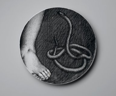 Piero Fornasetti (Italian, 1913-1988). <em>Plate, Eva</em>, ca. 1954. Glazed earthenware, 1 x 10 1/4 x 10 1/4 in. (2.5 x 26 x 26 cm). Brooklyn Museum, Gift of the Estate of Jane Adams Breed, 2005.37.9. Creative Commons-BY (Photo: Brooklyn Museum, 2005.37.9_PS2.jpg)