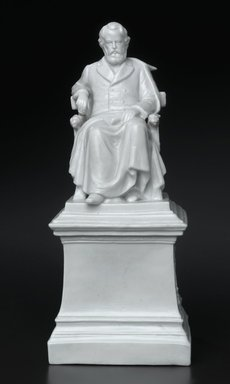 Unknown. <em>Figure of Longfellow, after Franklin Simmons</em>, ca. 1907. Porcelain, 7 5/8 x 3 1/4 x 3 3/8 in. (19.4 x 8.3 x 8.6 cm). Brooklyn Museum, Gift of M. Christmann Zulli in memory of Anna Nastasi, 2005.67. Creative Commons-BY (Photo: Brooklyn Museum, 2005.67_PS1.jpg)