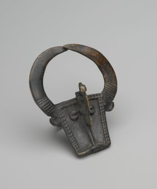Bwa. <em>Ring with Bushcow and Chameleon</em>, 19th century. Copper alloy, 3 1/16 x 2 7/16 x 1 3/4 in. (7.8 x 6.3 x 4.5 cm). Brooklyn Museum, Gift of Dr. Werner Muensterberger and Michael Ward, 2006.66.6. Creative Commons-BY (Photo: Brooklyn Museum, 2006.66.6_PS6.jpg)