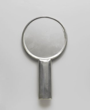 Queens Art Pewter, Ltd. (1930-2000). <em>Hand Mirror</em>, ca. 1935. Pewter, silvered glass, 9 1/8 x 5 x 3/4 in. (23.2 x 12.7 x 1.9 cm). Brooklyn Museum, Bequest of H. Randolph Lever, by exchange, 2007.21.2. Creative Commons-BY (Photo: Brooklyn Museum, 2007.21.2_front_PS6.jpg)