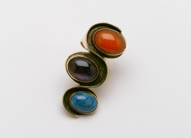 Art Smith (American, born Cuba, 1917-1982). <em>Undulation Ring</em>, ca. 1961. Gold, chrysocola, amethyst, carnelian, 1 1/4 x 2 3/8 x 1 1/8 in. (3.2 x 6 x 2.9 cm). Brooklyn Museum, Gift of Charles L. Russell, 2007.61.12. Creative Commons-BY (Photo: Brooklyn Museum, 2007.61.12_PS2.jpg)