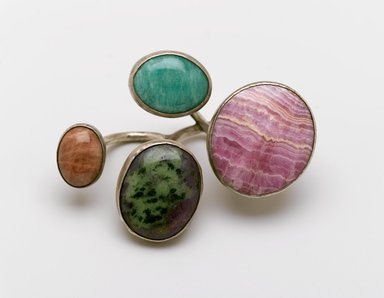 Art Smith (American, born Cuba, 1917-1982). <em>Cluster Knuckles Ring</em>, ca. 1968. Silver alloy, rhodochrosite, jade (?), turquoise (?), zoisite (?), 1 1/2 x 3 1/2 x 2 1/2 in. (3.8 x 8.9 x 6.4 cm). Brooklyn Museum, Gift of Charles L. Russell, 2007.61.17. Creative Commons-BY (Photo: Brooklyn Museum, 2007.61.17_PS2.jpg)