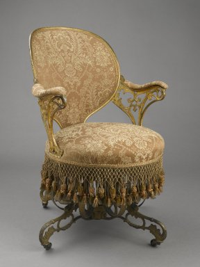 Thomas E. Warren (American, born 1808). <em>Centripital Spring Chair</em>, ca. 1849-1858. Cast iron, wood, modern upholstery, modern trim, original fringe, 34 1/4 x 23 1/2 x 28 1/4 in. (87 x 59.7 x 71.8 cm). Brooklyn Museum, Designated Purchase Fund, 2009.27. Creative Commons-BY (Photo: Brooklyn Museum, 2009.27_threequarter_PS6.jpg)