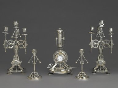 Andre´ Romain Guilmet (1827-1892). <em>Clock, Part of a Five Piece Clock Garniture</em>, ca. 1880. Nickel-plated metal, glass, paper, mercury, height: 15 1/2 x 8 x 8 in. (39.4 x 20.3 x 20.3 cm). Brooklyn Museum, Gift of Marcus S. Friedlander, by exchange, 2009.49.1. Creative Commons-BY (Photo: , 2009.49.1-.5_PS6.jpg)