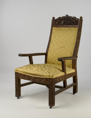 Lockwood de Forest (American, 1850-1932). <em>Armchair</em>, ca. 1895. Teak, old but not original textile, metal, 47 1/8 x 26 x 29 1/2 in. (119.7 x 66 x 74.9 cm). Brooklyn Museum, Gift of Lisa M. Price, by exchange and H. Randolph Lever Fund, 2009.72. Creative Commons-BY (Photo: Brooklyn Museum, 2009.72_PS6.jpg)