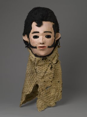 Chewa. <em>'Elvis' Mask for Nyau Society</em>, ca. 1977. Wood, paint, fiber, cloth, 11 x 9 1/2 x 7 1/4 in. (27.9 x 24.1 x 18.4 cm). Brooklyn Museum, Gift of Mr. and Mrs. J. Gordon Douglas III, Frederick E. Ossorio, and Elliot Picket, by exchange and Designated Purchase Fund, 2010.41. Creative Commons-BY (Photo: Brooklyn Museum, 2010.41_PS6.jpg)