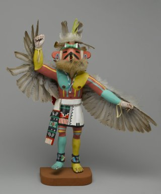 Henry Shelton (born 1929). <em>Kachina Doll</em>, 1960-1970. Cottonwood root, acrylic pigment, feathers, hide, fur, beads, yarn,  cotton, 16 1/2 x 14 x 8 in. (41.9 x 35.6 x 20.3 cm). Brooklyn Museum, Gift of Edith and Hershel Samuels, 2010.6.10. Creative Commons-BY (Photo: Brooklyn Museum, 2010.6.10_front_PS2.jpg)