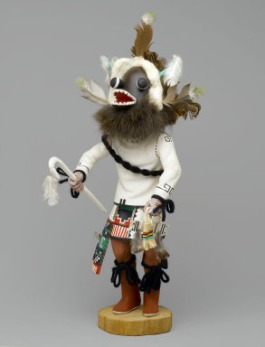 Henry Shelton (born 1929). <em>Kachina Doll</em>, 1960-1970. Cottonwood root, acrylic paint, yarn, feather, fur, leather, cotton, 17 x 5 3/4 x 8 1/4 in. (43.2 x 14.6 x 21 cm). Brooklyn Museum, Gift of Edith and Hershel Samuels, 2010.6.11. Creative Commons-BY (Photo: Brooklyn Museum, 2010.6.11_front_PS2.jpg)