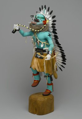 Orin Poley. <em>Kachina Doll</em>, 1960-1970. Cottonwood root, acrylic pigment, hide, feathers, shell, fur,  turquioise, metal, 17 3/4 x 6 x 9 in. (45.1 x 15.2 x 22.9 cm). Brooklyn Museum, Gift of Edith and Hershel Samuels, 2010.6.1. Creative Commons-BY (Photo: Brooklyn Museum, 2010.6.1_threequarter_left_PS2.jpg)