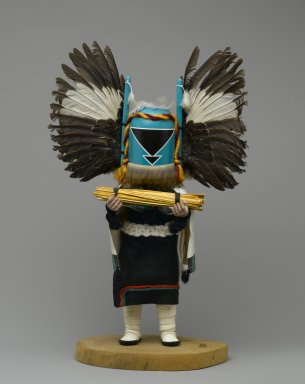 Seona. <em>Kachina Doll</em>, 1960-1970. Cottonwood root, acrylic paint, feathers, fur, hide, synthetic wool and yarn, painted canvas, 15 x 9 x 4 1/2 in. (38.1 x 22.9 x 11.4 cm). Brooklyn Museum, Gift of Edith and Hershel Samuels, 2010.6.2. Creative Commons-BY (Photo: Brooklyn Museum, 2010.6.2_front_PS2.jpg)