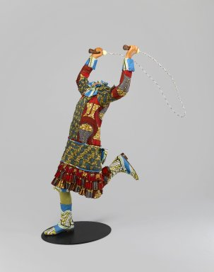 Yinka Shonibare MBE (British-Nigerian, born 1961). <em>Skipping Girl</em>, 2009. Life-size fiberglass mannequin, Dutch wax printed cotton, mixed media, installed: 50 1/4 x 29 x 43 in. (127.6 x 73.7 x 109.2 cm) height measured from top of proper left hand; width measured from elbow to the rope in proper right hand; depth measured from the front of the back to the back of the rope. Brooklyn Museum, Gift of Edward A. Bragaline and purchase gift of William K. Jacobs, Jr., by exchange and Mary Smith Dorward Fund, 2010.8. © artist or artist's estate (Photo: Brooklyn Museum, 2010.8_PS6.jpg)