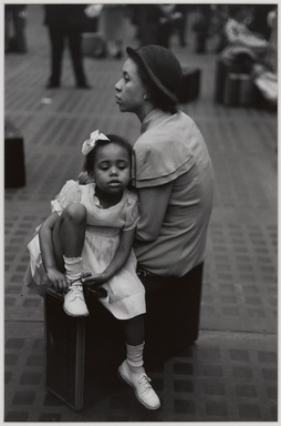 Ruth Orkin (American, 1921-1985). <em>Mother and Daughter at Penn Station, NYC</em>, 1948. Gelatin silver photograph, sheet: 13 15/16 × 11 in. (35.4 × 27.9 cm). Brooklyn Museum, Gift of Mary Engel, 2011.22.3. © artist or artist's estate (Photo: , 2011.22.3_PS9.jpg)