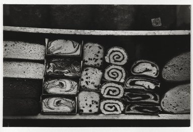 Nathan Lerner (American, 1913-1997). <em>Cakes in Window, New York</em>, 1937, printed later. Gelatin silver photograph mounted on board, mat: 16 7/8 x 14 in. (42.9 x 35.6 cm). Brooklyn Museum, Gift of Kiyoko Lerner, 2011.25.42. © artist or artist's estate (Photo: Brooklyn Museum, 2011.25.42_PS6.jpg)