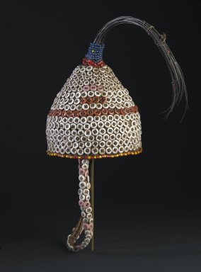 Lega. <em>Bwami Hat for Kindi Level</em>, early 20th century. Plant fiber, buttons, glass beads, elephant tail hair