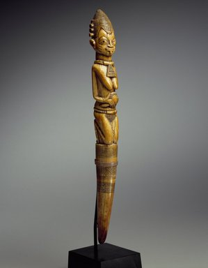 Yorùbá. <em>Divination Tapper (Iroke Ifá)</em>, 18th century (possibly). Ivory, 13 x 1 1/2 x 1 1/2 in. (33 x 3.8 x 3.8 cm). Brooklyn Museum, Collection of Beatrice Riese, 2011.4.1. Creative Commons-BY (Photo: Brooklyn Museum, 2011.4.1_SL3.jpg)