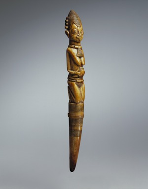 Yorùbá. <em>Divination Tapper (Iroke Ifá)</em>, 18th century (possibly). Ivory, 13 x 1 1/2 x 1 1/2 in. (33 x 3.8 x 3.8 cm). Brooklyn Museum, Collection of Beatrice Riese, 2011.4.1. Creative Commons-BY (Photo: Brooklyn Museum, 2011.4.1_SL3_edited.jpg)