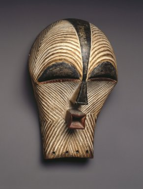 Songye. <em>Mask (Kifwebe)</em>, late 19th or early 20th century. Wood, pigment, 12 x 7 1/8 x 6 1/8 in. (30.5 x 18.1 x 15.6 cm). Brooklyn Museum, Collection of Beatrice Riese, 2011.4.2. Creative Commons-BY (Photo: Brooklyn Museum, 2011.4.2_threequarter_SL1.jpg)