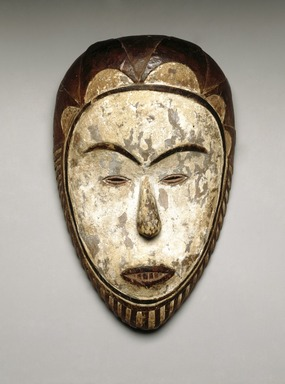 Fang (Betsi subgroup) artist. <em>Face mask (ñgontang)</em>, late 19th century. Wood, kaolin, pigment, 11 1/8 x 7 x 2 1/4 in. (28.3 x 17.8 x 5.7 cm). Brooklyn Museum, Collection of Beatrice Riese, 2011.4.6. Creative Commons-BY (Photo: Brooklyn Museum, 2011.4.6_SL1_edited.jpg)