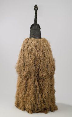 Gola. <em>Helmet Mask (Gbetu) with Raffia Costume</em>, early to mid 20th century. Wood, pigment, metal, raffia, 93 x 48 in. (236.2 x 121.9 cm). Brooklyn Museum, Gift of William C. Siegmann, 2011.53.1a-b. Creative Commons-BY (Photo: Brooklyn Museum, 2011.53.1a-b_PS6.jpg)