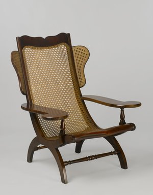 Unknown. <em>Easy Chair (Butaca)</em>, second quarter 19th century. Mahogany, cane, 43 x 35 3/4 x 35 3/8 in. (109.2 x 90.8 x 89.9 cm). Brooklyn Museum, Gift of Mrs. J. Fuller Feder, by exchange and Brooklyn Museum Collection, 2011.58.1. Creative Commons-BY (Photo: Brooklyn Museum, 2011.58.1_PS6.jpg)