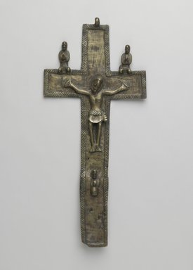 Kongo. <em>Crucifix (Nkangi Kiditu)</em>, early 17th century. Copper alloy, 13 1/2 x 6 x 1 in. (34.3 x 15.2 x 2.5 cm). Brooklyn Museum, Gift of Jean C. and Raymond E. Britt Jr. Collection, by exchange