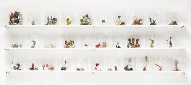 Yuji Agematsu (Japanese, born 1956). <em>Zip; 03-01-12....03-31-12</em>, 2012. Mixed media (wood, latex paint, drywall screws, cigarette cellophane wrapper, gum, metal, plastic, glass shards, eraser, acrylic fingernail, thread, metal screw, dust, penny, seed pod, hair, dried grass, razor blade, rubber fitting, tar, aquarium pebbles, rocks, plastic doll part, soil), shelf dimensions: 11 x 2 1/2 x 30 in. (27.9 x 6.4 x 76.2 cm). Brooklyn Museum, Dorothy and Herbert Vogel Gallerist Award, 2012.30.3a-c. © artist or artist's estate (Photo: Brooklyn Museum, 2012.30.3_PS9.jpg)