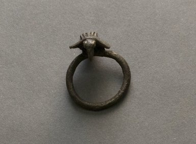 Senufo. <em>Ring with Bird</em>, early 20th century. Bronze, 1 3/16 x 1 in. (3 x 2.5 cm). Brooklyn Museum, Gift of Jerome Vogel, 2012.76.12. Creative Commons-BY (Photo: Brooklyn Museum, 2012.76.12_PS10.jpg)