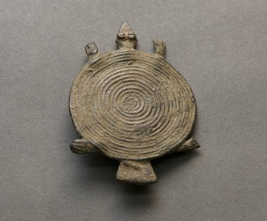 Senufo. <em>Turtle Pendant</em>, early 20th century. Bronze, 3/16 x 1 7/8 x 2 11/16 in. (0.5 x 4.8 x 6.8 cm). Brooklyn Museum, Gift of Jerome Vogel, 2012.76.15. Creative Commons-BY (Photo: Brooklyn Museum, 2012.76.15_PS10.jpg)
