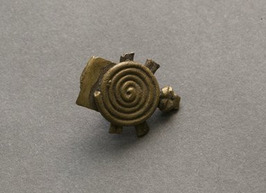 Senufo. <em>Turtle Pendant</em>, early 20th century. Bronze, 3/8 x 11/16 x 1/4 in. (1 x 1.8 x 0.7 cm). Brooklyn Museum, Gift of Jerome Vogel, 2012.76.17 (Photo: Brooklyn Museum, 2012.76.17_front_PS10.jpg)